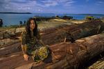 Lisa Paciulli, infant Kloss gibbon, logged rainforest trees and logging barge at Log Pond.