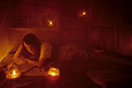 Lisa Paciulli reviews her research data by candlelight