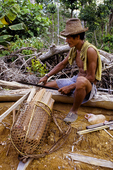 A Mentawain man cuts firewood in illegally logged area of Betumonga Research Station