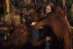 Birute Galdikas holds onto a bucket filled with milk meant for juvenile bornean orangutans