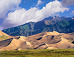 Sand dunes with Sangre de Cristo Mountains in the background, Great Sand Dunes National Park and Preserve, Colorado