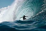 Surfer rides wave, Pipeline, Oahu, Hawaii