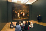 School children visiting the Rijksmuseum in Amsterdam viewing The Nightwatch by Rembrandt van Rijn.