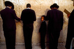 Hasidic father and son praying at the Western Wall.