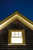 Cottage window on a starry night.
