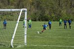 Penalty kick during youth soccer game.