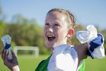 Happy youth soccer player after a game.