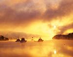 Spectacular Sunrise and Ground Fog over Boats