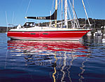 Close-up view of Red Sloop and Reflections