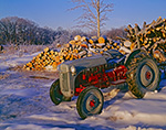 1952 Ford Tractor Covered in Ice with Woodpile