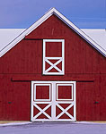 Red and White Doors on New Barn in Winter