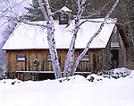 Natural Wood Barn with Holiday Wreath and Birch Trees in Winter