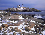 Nubble Light in Winter with Rocky Shoreline in Foreground