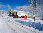 Red Barn and Country Road under Bright Blue Skies after Snowstorm