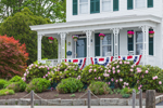 Rhododendrons in Bloom and Patriotic Banners on Porch in Spring, View from Mystic River, West Mystic, CT