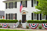 Ebenezer Hayden House (Built 1778) with American Flag and Patriotic Bunting on White Picket Fence, Essex, CT