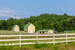 Yellow Barns with White Fences on Large Farm Estate, Andover, ME