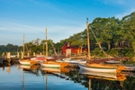 Early Morning Light Shines on Hereshoff Sailboats and Red Boat House in Hadley Harbor, Naushon Island, Elizabeth Islands, Town of Gosnold, MA