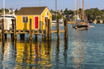 Little Yellow Dock House with Red Door on Tisbury Wharf, Vineyard Haven Harbor, Martha's Vineyard, Tisbury, MA