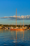 Early Morning Light Shines on Red Wooden Sloop in Vineyard Haven Harbor, Martha's Vineyard, Tisbury, MA