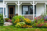 Colorful Flower Gardens and Front Porch of Cottage in Bass Harbor, Tremont, ME