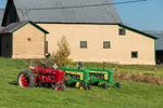 Two John Deere and One McCormick International Farmall Tractors with Barn in Background, Fairfield, VT
