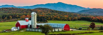 Sunset over Red Barns and Farm in Fall with Mount Mansfield in Distance, Fletcher, VT
