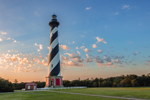 First Light Shines on Cape Hatteras Lighthouse at Sunrise, Cape Hatteras National Seashore, Outer Banks, Hatteras Island, NC