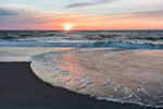 Sunrise over Surf and Sandy Beach along Atlantic Ocean at Assateague Island National Seashore, Assateague Island, MD