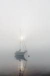 Sun Breaking Through Fog over Sailboat