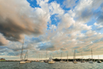 Sky filled with White Puffy Clouds over Boats in Cuttyhunk Pond, Cuttyhunk Island, Elizabeth Islands, Town of Gosnold, MA