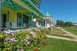 Flower Gardens at Yellow and Green Gingerbread House on Ocean Park, Martha's Vineyard, Oak Bluffs, MA