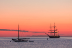 "Sunrise over Tallship ""Oliver Hazzard Perry"" and Sloop in Cuttyhunk Harbor, Cuttyhunk Island, Elizabeth Islands, Town of Gosnold, MA"