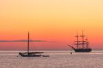 "Sunrise over Tallship ""Oliver Hazzard Perry"" and Sloop in Cuttyhunk Harbor, Cuttyhunk Island, Elizabeth Islands, Town of Gosnold, MA"