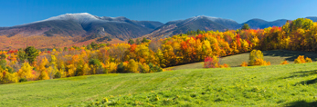 Green Field, Fall Foliage, and Franconia Range with Snow-capped Mount Lafayette and Cannon Mountain, White Mountain National Forest, View from Sugar Hill, NH