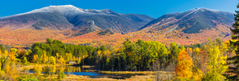 Fields, Wetlands, and Franconia Range with Snow-capped Mount Lafayette and Cannon Mountain in Fall, White Mountain National Forest, View from Sugar Hill, NH