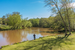 Fisherman on Banks of South Fork Broad River in Spring, Watson Mill Bridge State Park, Piedmont Region, Madison County, Comer, GA