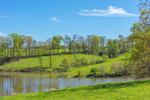 Small Pond and Rolling Green Pastures in Spring, Piedmont Region, Hall County, Gillsville, GA