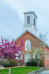 Federated Church of Christ, Universalist Unitarian, with Flowering Cherry Tree and Flowering Dogwood Tree in Bloom in Spring, Brooklyn, CT