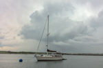 Dark Storm Clouds over Boat in Gosport Harbor, Isles of Shoals, View from Rye, NH out to Smuttynose Island, Kittery, ME