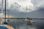 Dark Storm Clouds over Boat in Gosport Harbor, Isles of Shoals, View from Rye, NH out to Smuttynose and Appledore Islands, Kittery, ME