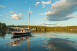 """Reflections of Clouds and Gaff-rigged Cutter Sailboat """"Sorceress"""" at The Basin in Late Evening Light, Phippsburg, ME"""