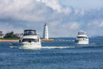 Motor Cruisers Entering Long Island Sound from Connnecticut River with Lynde Point Lighthouse in Background, Old Saybrook, CT