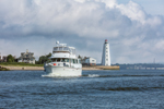 Motor Cruiser Entering Long Island Sound from Connnecticut River with Lynde Point Lighthouse in Background, Old Saybrook, CT
