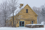 Yellow Wood Barn with Pots and Woodpile in Winter, The Pottery Works Barn, Fitzwilliam, NH