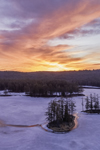 Aerial View of a Frozen-Over Tully Lake at Sunrise in Winter, Royalston, MA