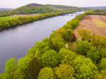 Aerial View of Farm Fields and Connecticut River in Spring with Mount Sugarloaf in Background, Sunderland, MA