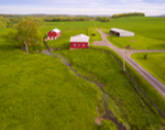 Aerial View of Red Barns and Pastures in Spring on Farm in Hudson Valley, Taconic Mountains Region, Hamlet of Ancramdale, Ancram, NY