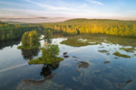 Aerial View of Early Morning Light Shining over Harvard Pond and Forest in Spring, Petersham, MA