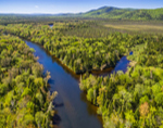 Aerial View of Magalloway River with Diamond Peaks and Mt. Dustan in Background, View from Lincoln, ME